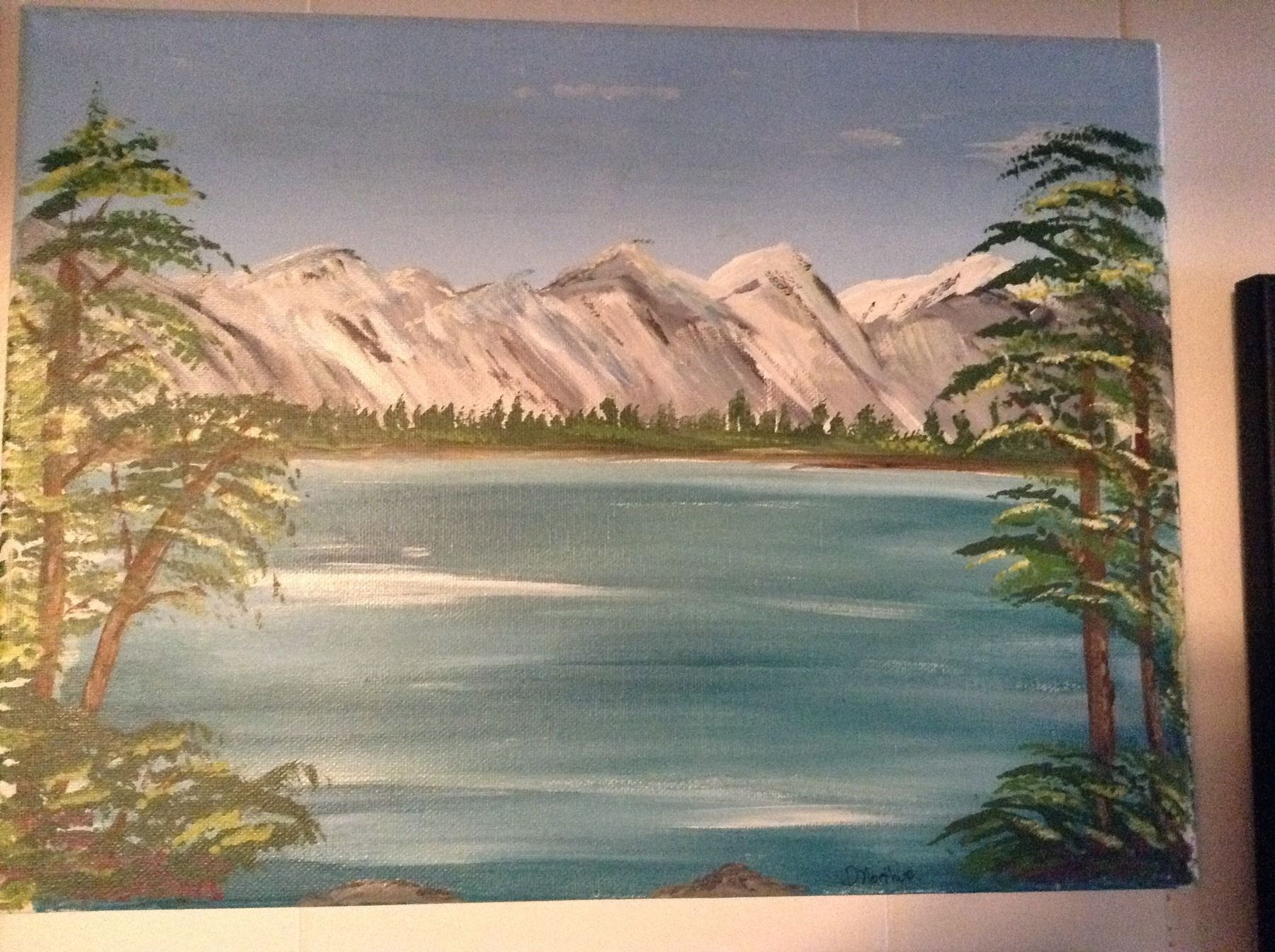 Done in acrylic on canvas this mountain scene with a beautiful lake and trees off to the side, soft colors and really makes you feel you are part of the picture
