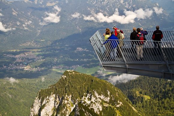 View from AlpspiX Viewing Platform, Germany  At the end of the structure, visitors reach a glass wall and have a sensational view of the nearby cliffs, the breathtaking alpine panorama and almost 1000 meters (3281 feet) down into the depths.