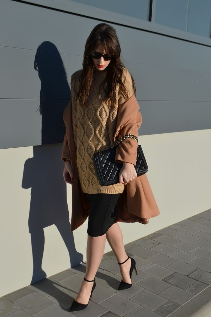 Go for a classic style in a camel coat and a black pencil skirt. This outfit is complemented perfectly with black suede pumps.   Shop this look on Lookastic: https://lookastic.com/women/looks/coat-cable-sweater-pencil-skirt/14849   — Tan Cable Sweater  — Camel Coat  — Black Quilted Leather Crossbody Bag  — Black Pencil Skirt  — Black Suede Pumps