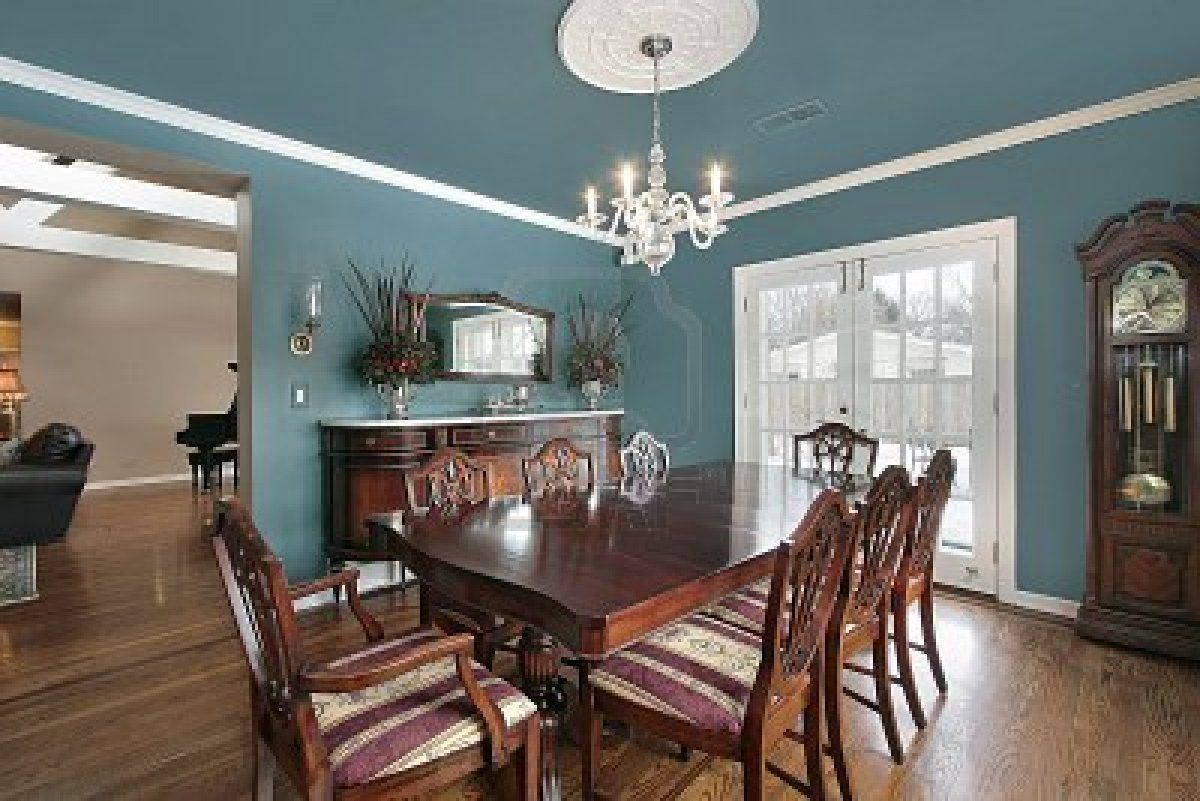 Elegant Dining Room With Slate Blue Walls Stock Photo  Decorating Gorgeous Dining Room Wall Pictures Design Ideas