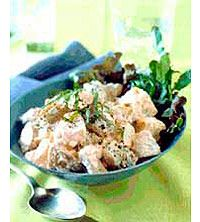 A creamy dressing of mayonnaise, vinegar, and pan-roasted tomatoes gives this potato salad its pinkish hue and great taste.