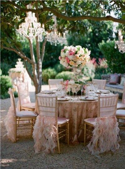 stunning setting: chairs, chandeliers, flowers