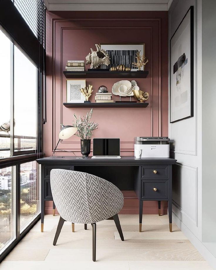 Photo of Desk with modern mid-century office chair and pink accent wall – living room decoration