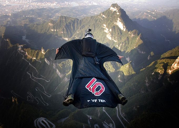 Contest Of Flying People Held In China Wingsuit Flying Is The Sport Of Flying Through The Air Using A Special Jumpsuit C Flying People Base Jumping Air Sports Base jump wallpaper hd
