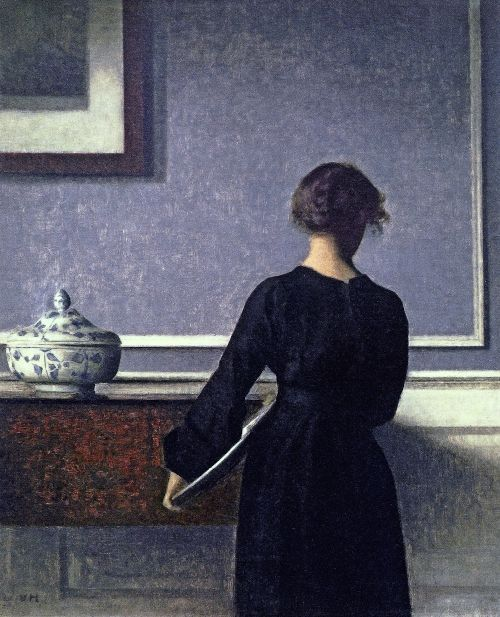 Young Woman seen from Behind by Vilhelm Hammershoi