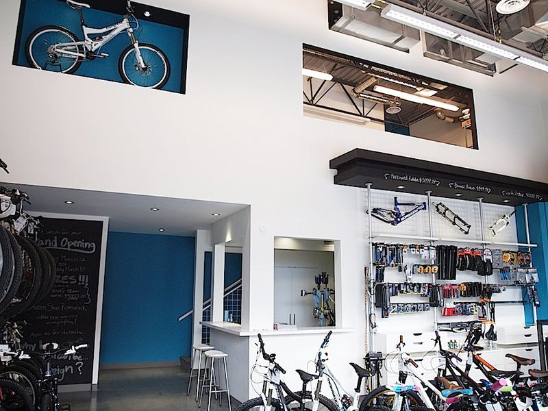 A contemporary bicycle shop retail design by hatch for Office design kelowna