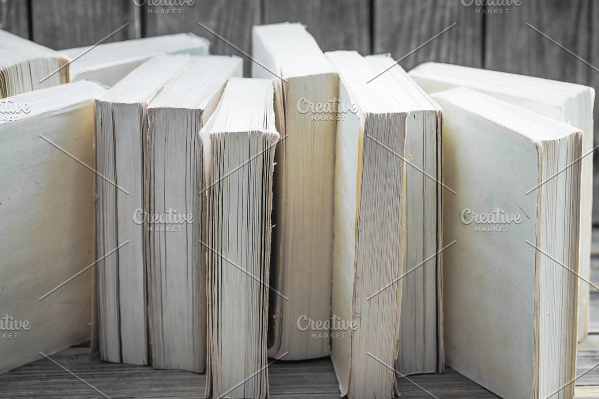 book on wooden background with space for text concept of knowledge