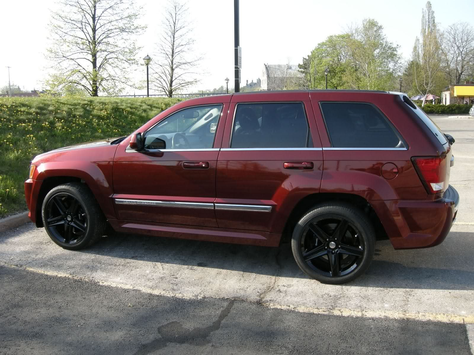 2005 Jeep Grand Cherokee With Black Rims On Rock Red