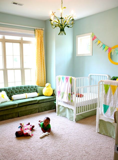 Colorful shared nursery. Love that sofa! Love the green sofa! Beautiful! Love the two cribs! Memories of my twin girls when they were little babes! Very cute!!!