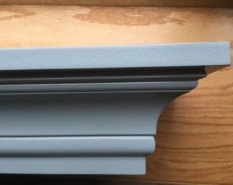 This Shelf Is A Crown Molding Floating Fireplace Mantle Shelf Painted A Refreshing Light Grey It Floating Mantel Floating Mantel Shelf Fireplace Mantel Shelf