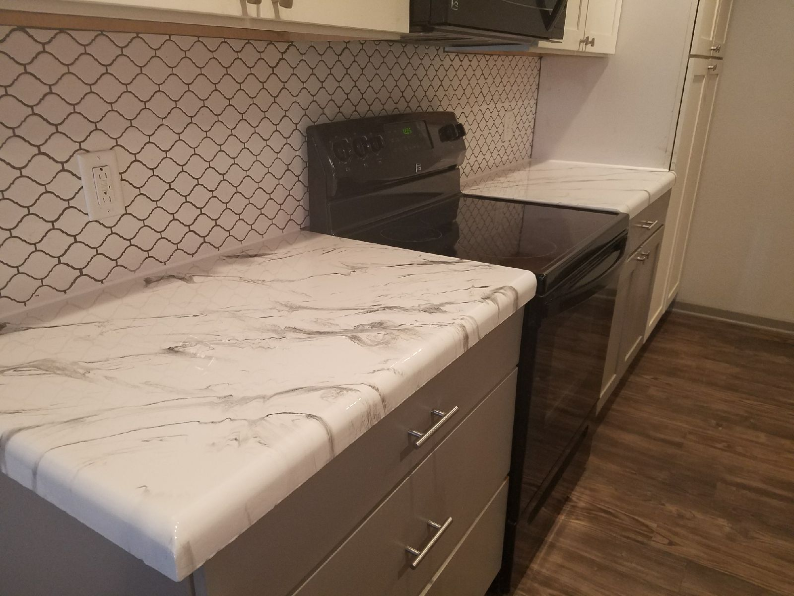 Epoxy Kitchen Countertops Over Existing Concrete Countertops In The Color Of White Marble Wit Recycled Glass Countertops Countertop Remodel Kitchen Countertops