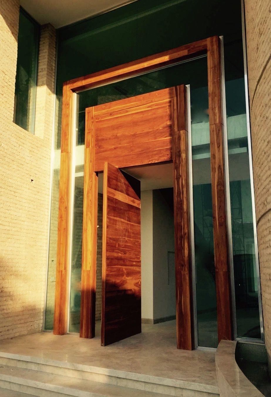 Beautiful wooden fritsjurgens pivot entrance doors in a villa in