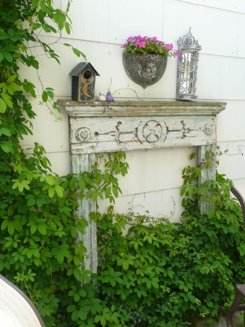 Placing an antique mantel outdoors is not only beautiful, but also serves several functions - storing potted plants, bird feeders, gardening tools - you name it! #gardening #design #outdoor #yard