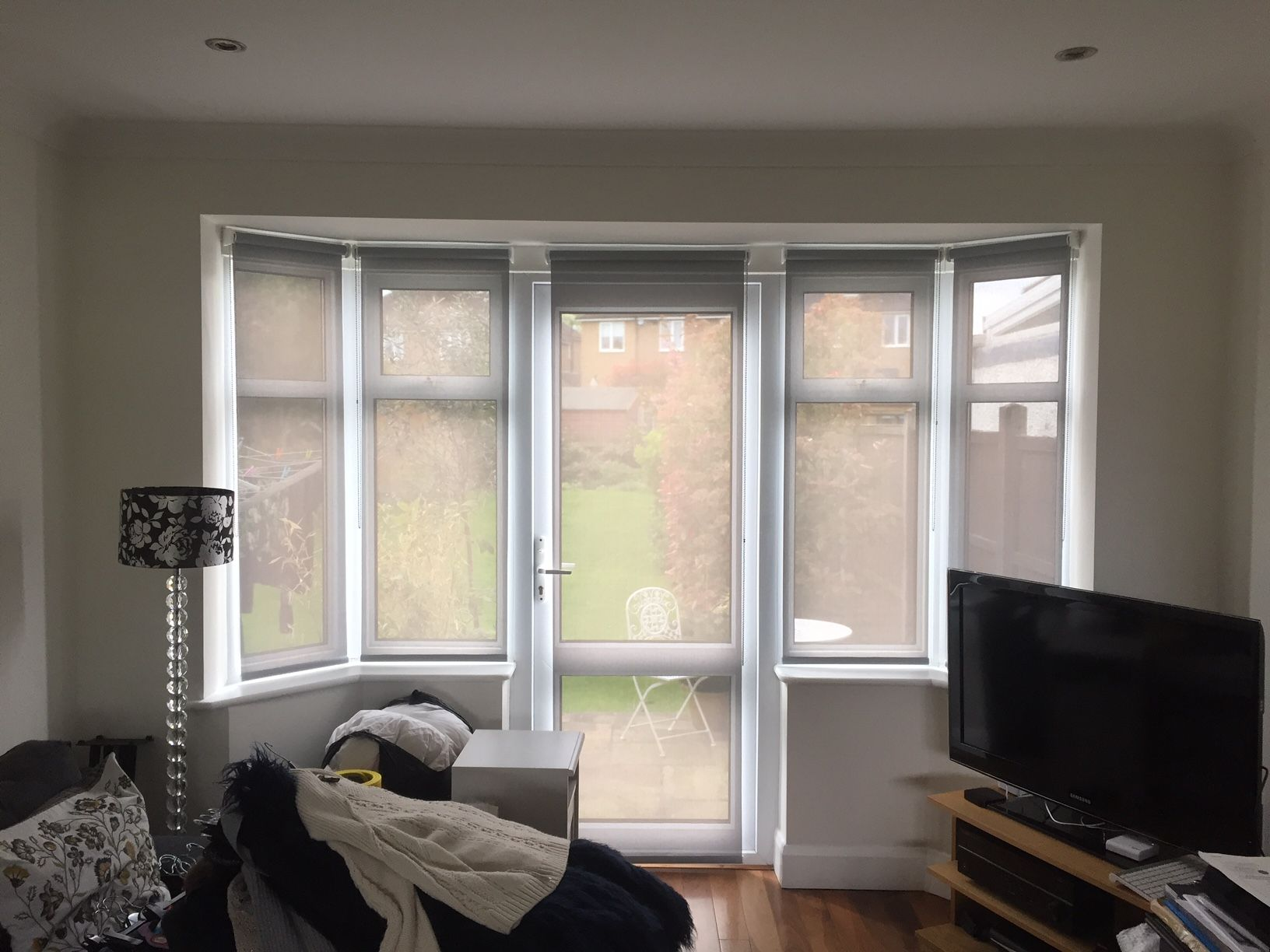 Sunscreen Roller Blinds On Door And Windows In Living Room