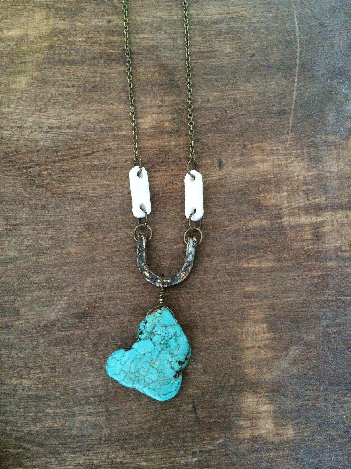 Menus turquoise stone pendant on antiqued u with bone connectors on