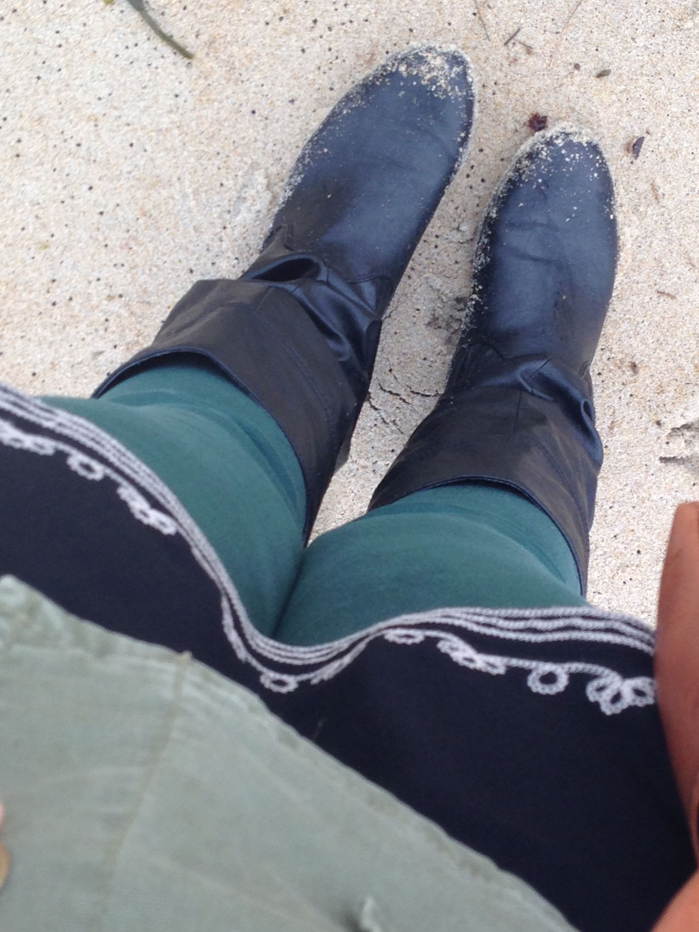 Boots, green skinnies, long black top & green army jacket