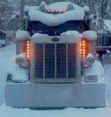 Angry lookin peterbilt big rig semi Been in one of these in worse snow!! COZY!!!!!!! They just plow right on through. Sometimes you can's see the road at all.