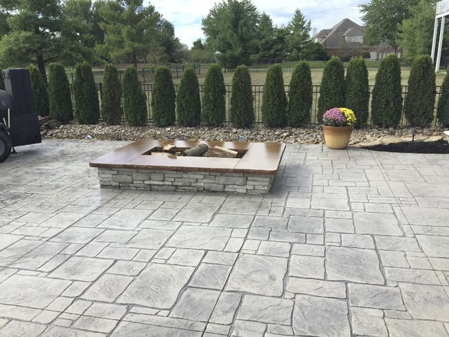 colored and stamped concrete patio lithochromea color hardener in
