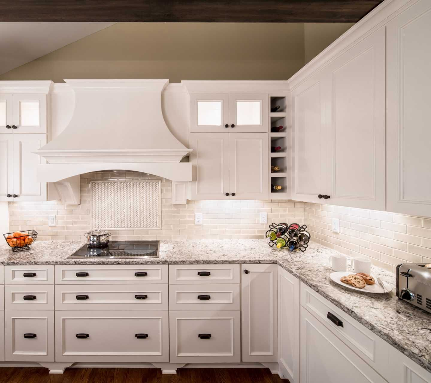 White Kitchen With Dark Backsplash: Cambria Bellingham With Dove White Cabinets, Travertine