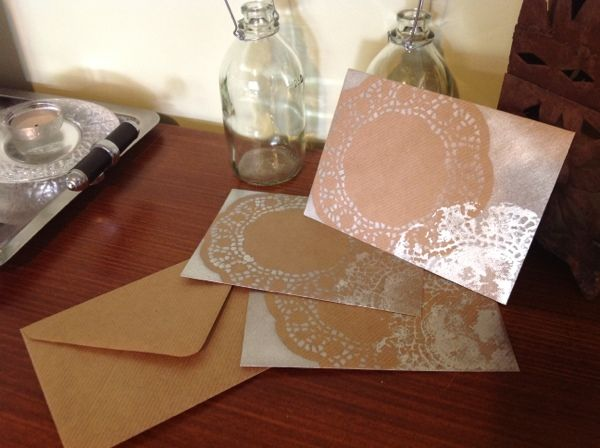Simple idea to style ordinary #envelopes, use a #doily as a #stencil with a spray can of #silver paint then print the excess paint on the doily onto to envelope.  www.howtobelovely.com.au