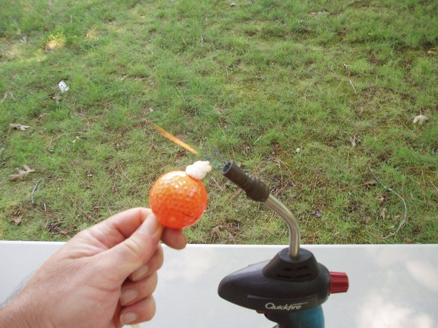 Diy ladder ball bolos made from golf balls ladder ball