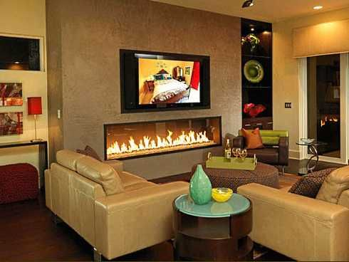linear fireplace with tile surround and tv above TV Over