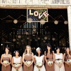 A rustic barn by the sea in Cayucos, California is the perfect setting for a simple and chic vintage wedding