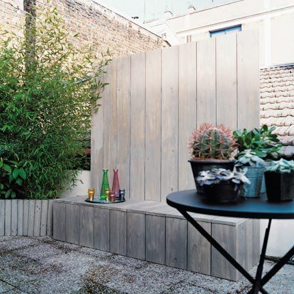 nice outdoor seating / privacy wall idea