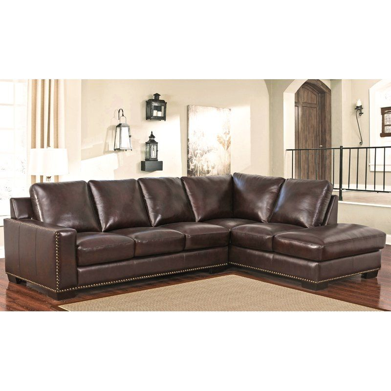 This top grain leather sectional is made to anchor any living space ...