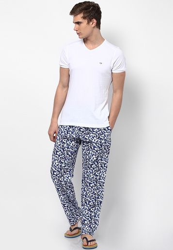 Breathe a new life into your wardrobe in the form of these blue coloured pyjamas for men by Jack & Jones. These regular-fit pyjamas will ensure a comfortable fit, courtesy the cotton fabric. Team these printed pyjamas with a T-shirt for a laidback look.