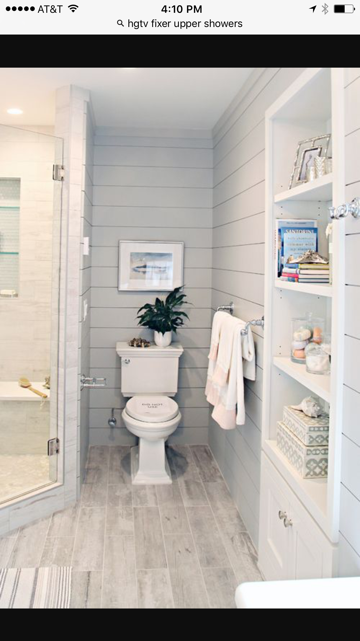 Color schemes: wood/gray tiles, white cabinetry, pale blue ...