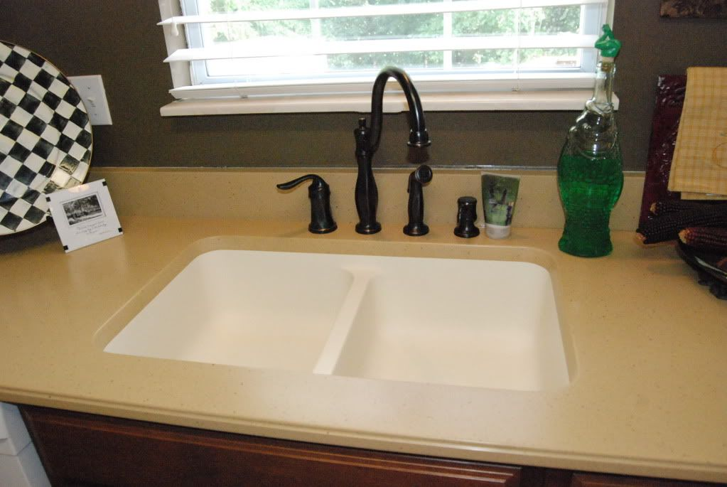 View of kitchen countertops are formica except for deep Corian bathroom sinks and countertops