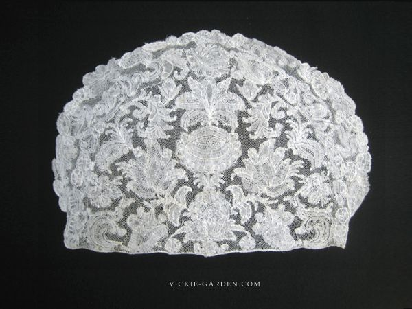 part of the head lace dress in the 18th century in what is said this panel is also the cap back with bonnet crown. Lappet fluttering in the wind attached to the back side of this panel, I was decorating around the curve of the front in the frill of the same lace