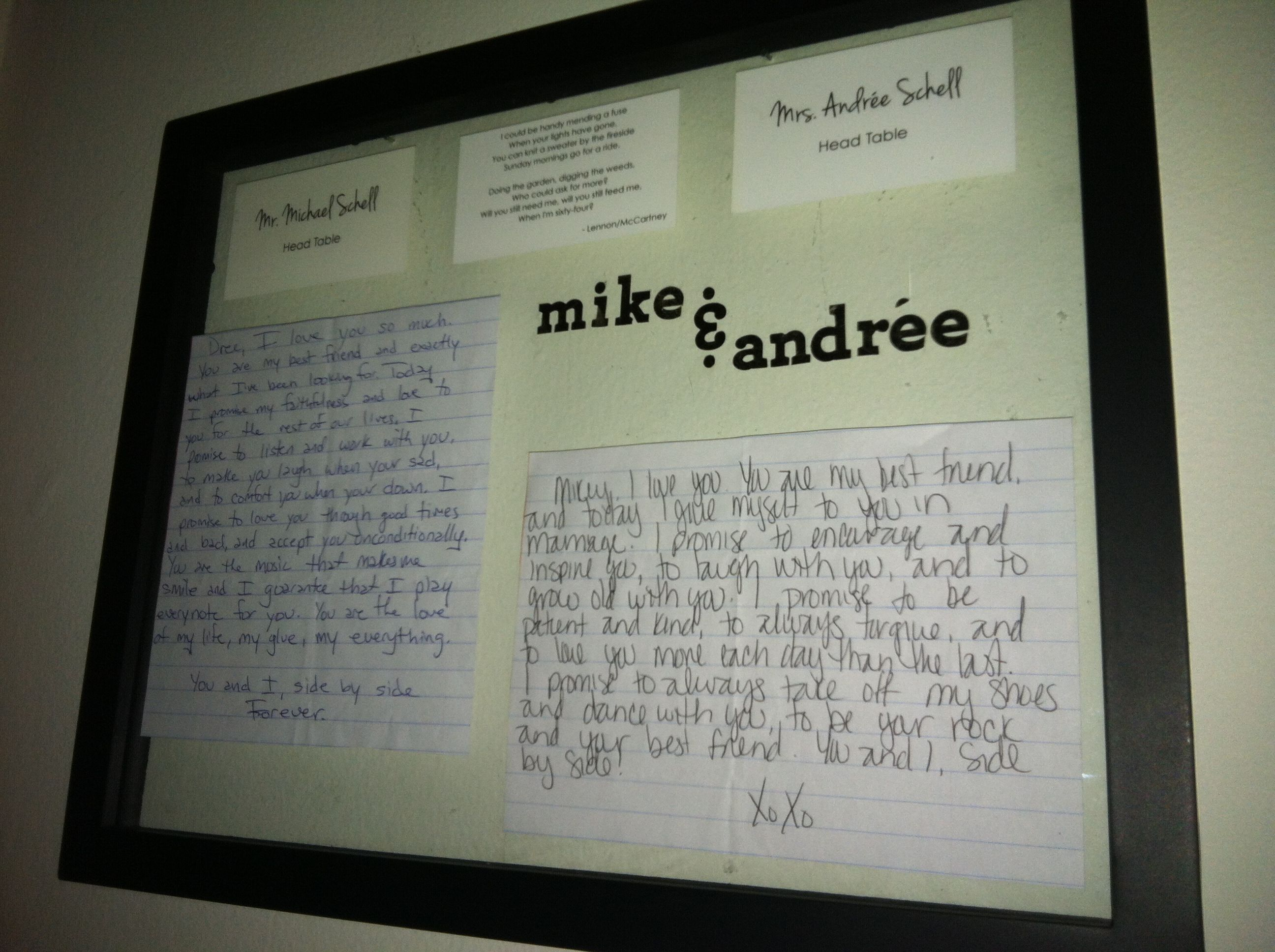 Wedding memories. Name cards, handwritten vows and some decorations in a shadow box frame.