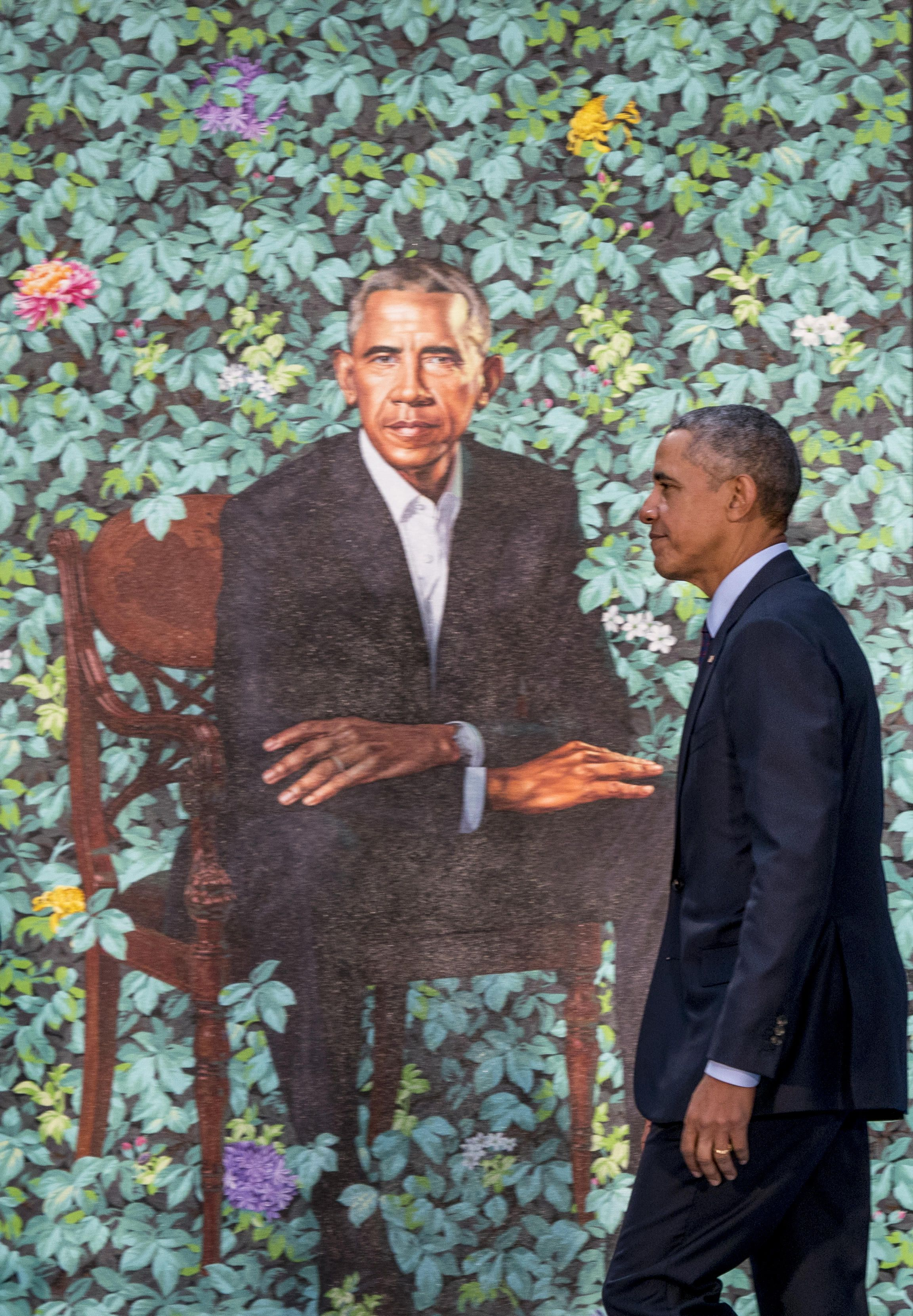 Presidential pose former president barack obama above walks past his official portrait yesterday