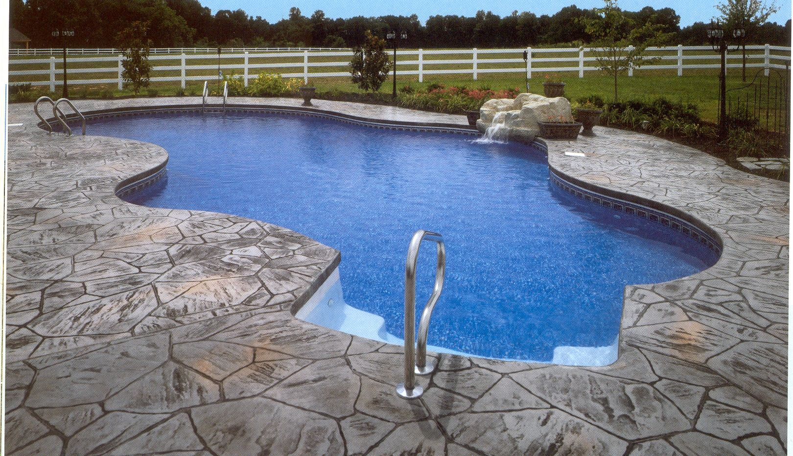 What A Cool Deck For A Mountain Lake Style Pool!
