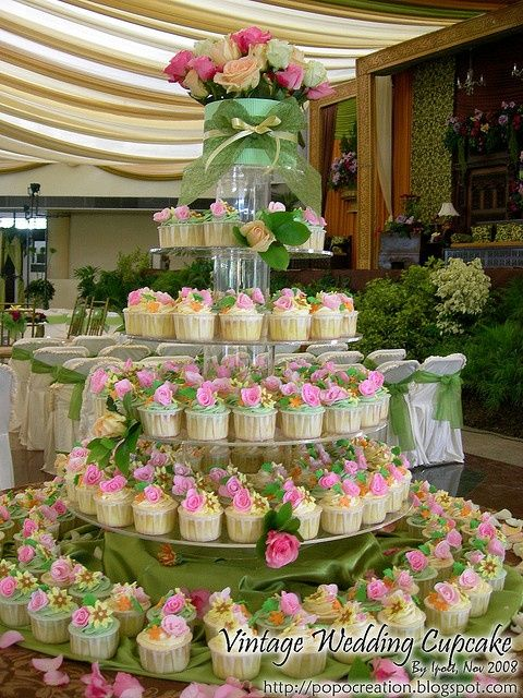 Garden-themed wedding cupcake tower - so beautiful #wedding #cupcake #cupcaketower #flowers #gardenparty