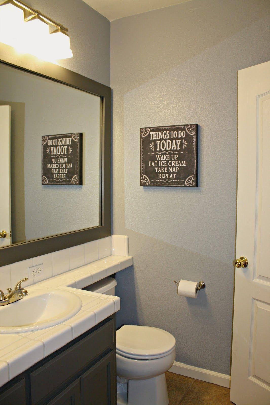 Grey Bathroom Framed In Mirror Pop Yellow In There Done Grey Bathrooms Bathroom Signs Bathroom
