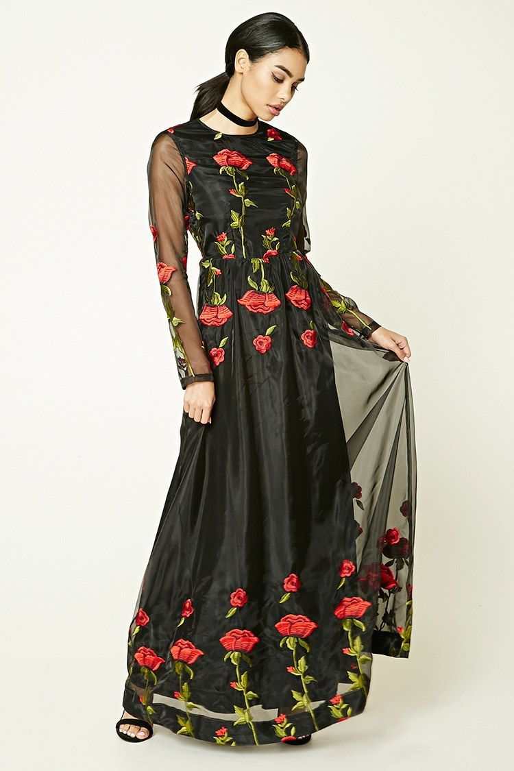 A mesh maxi dress featuring an embroidered floral applique design a