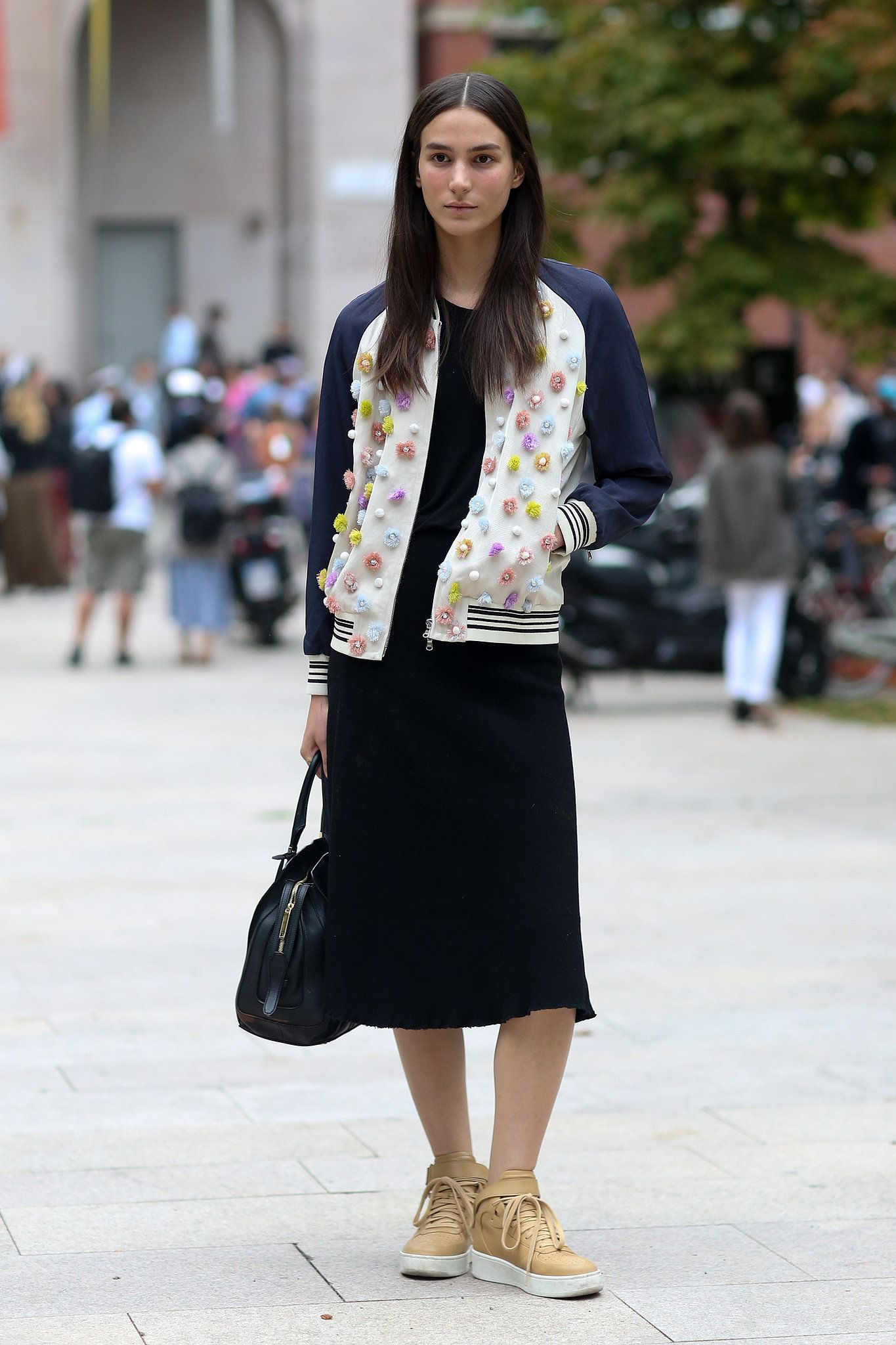 Milan Fashion Week: An embellished bomber looks totally cool with neutral sneakers.