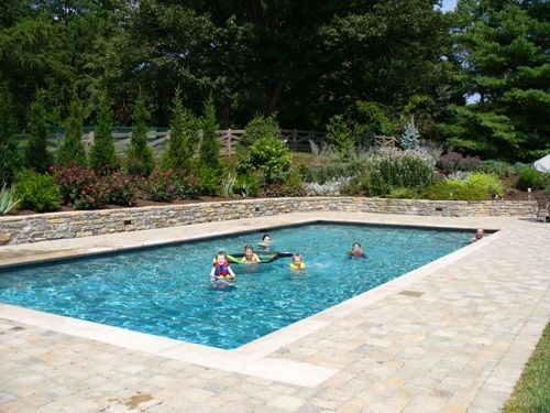 rectangular pool with sloping uphill retaining wall ... on Uphill Backyard Ideas  id=46165