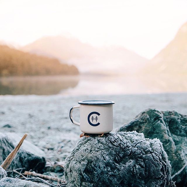 Beautiful morning sunrise waking up to Lake Gunn with our @home_camp enamel. All the rocks were covered in frost and the lake reflected the snow-capped mountains perfectly.  by helloemilie