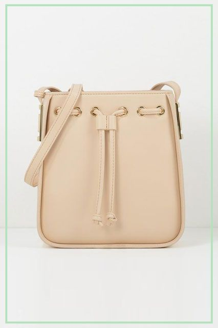 The Easiest Way To Update Your Wardrobe  A New Bag For Fall  refinery29  http   www.refinery29.com new-fall-handbag-trends-2015 slide-11 The  blushing bucket. 9e7cb791ae