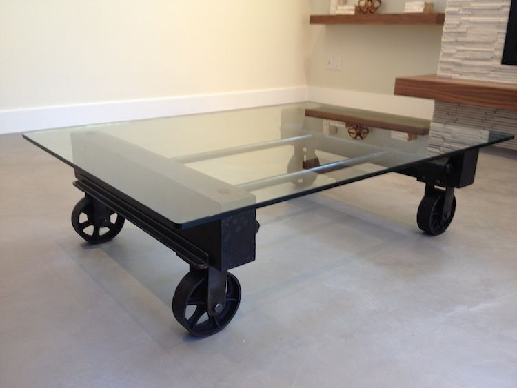 Glass coffee table, using steel casters, industrial remnants, gas pipes,  and reclaimed