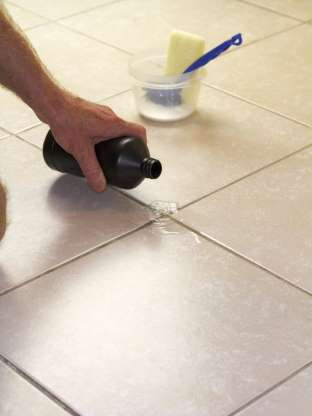 1 De Gunk Tile And Grout Istockphoto Com In 2020 Cleaning Ceramic Tiles Grout Cleaner Cleaning Hacks