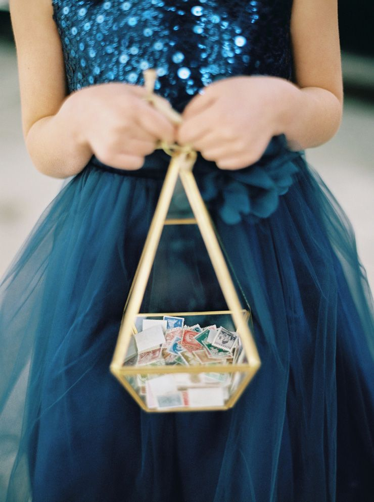 The flower girl wore a navy blue dress and she tossed stamps instead of rose petals | fabmood.com