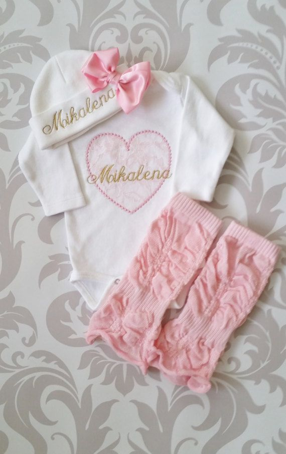 1b95eb675 ... name embroidered in metallic gold over pink lace appliqued heart with  leg warmers and hat with satin bow. The set includes the bodysuit, rouched  pink ...