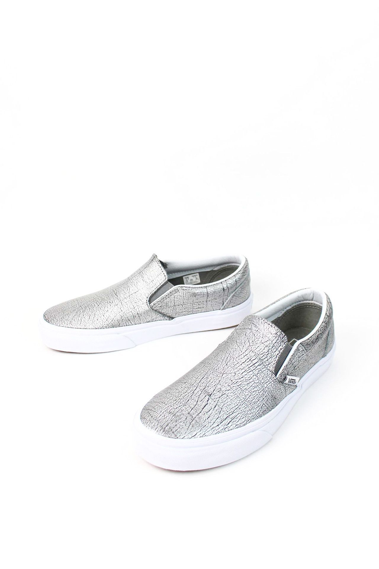 7acfcdf4e5 Vans The Foil Metallic Classic Slip-On features low profile slip-on leather  uppers