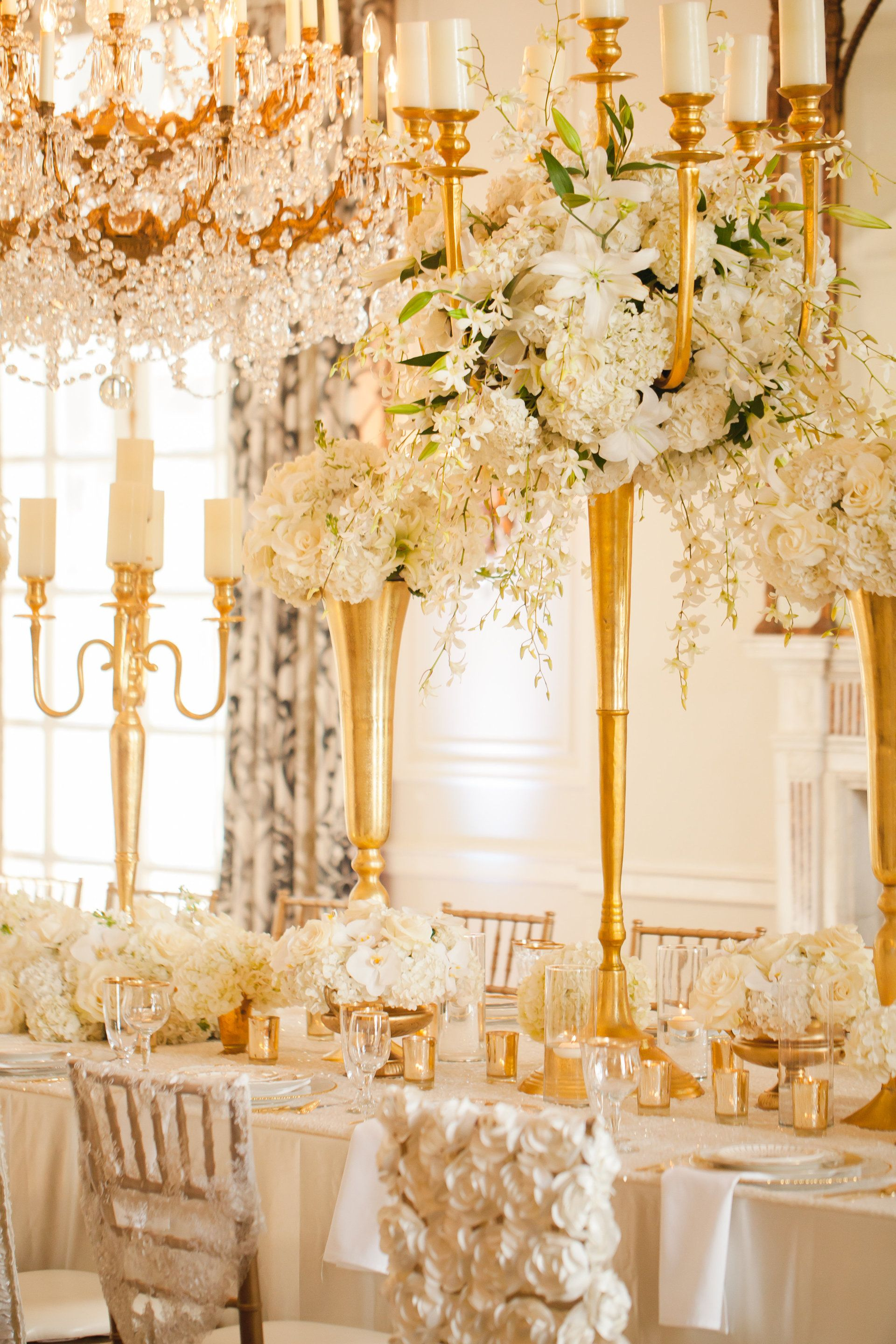 Glamorous Gold Indoor Wedding Reception Tall Cream Colored Floral Centerpieces Elegant Decor Ivory Wedding Decor Ivory Wedding Theme Gold Wedding Reception