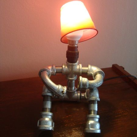 diy pipe lighting. galvanised pipe men table lamps sitting down with arms bent diy lighting